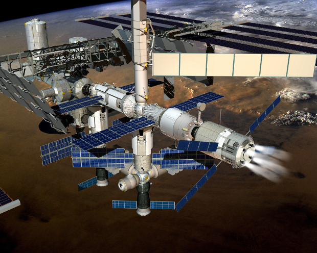 Artistic concept of the ATV-5 cargo spaceship breaking the International Space Station