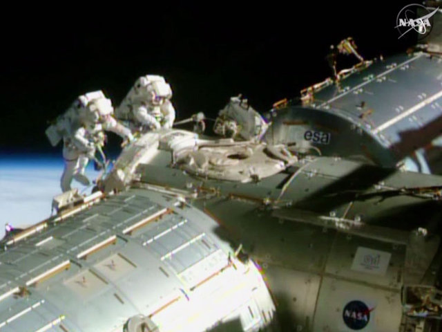 Barry Wilmore and Terry Virts during one of their spacewalks (Image NASA TV)