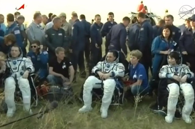 Terry Virts, Anton Shkaplerov and Samantha Cristoforetti assisted after their landing in the Soyuz TMA-15M spacecraft (Photo NASA TV, Anatoly Zak)