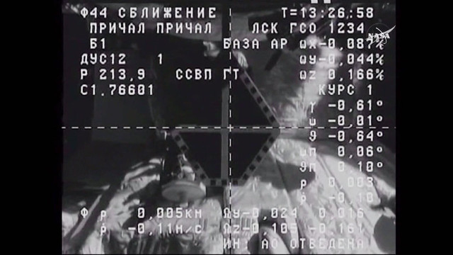 Image from a camera of the Progress MS-1 spaceship showing the docking target on the International Space Station during the approach maneuver (Image NASA TV)
