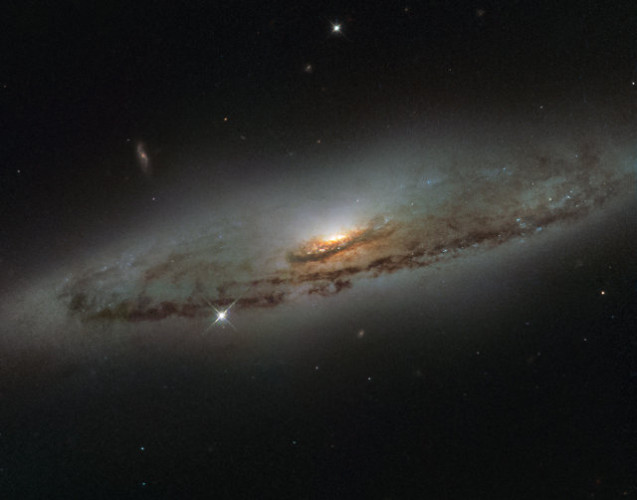 The galaxy NGC 4845 photographed by the Hubble Space Telescope (Image ESA/Hubble & NASA and S. Smartt (Queen's University Belfast))