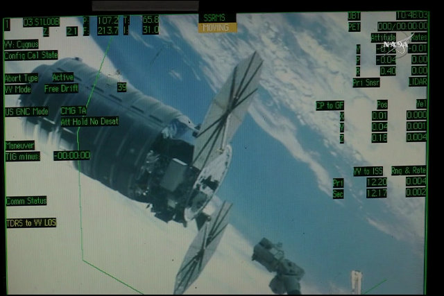 "The Cygnus ""Rick Husband"" spacecraft about to be captured by the Canadarm2 robotic arm (Image NASA TV)"