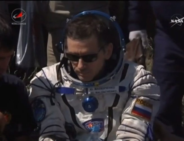 Yuri Malenchenko assisted by the staff after his landing (Image NASA TV)