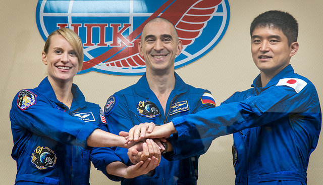 Kate Rubins, Anatoly Ivanishin and Takuya Onishi at a press conference before the launch (Photo NASA/Bill Ingalls)