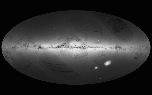 Sky map created using data collected by the Gaia space probe. At the center the Milky Way, in the lower right the Magellan Clouds (Image ESA/Gaia/DPAC)
