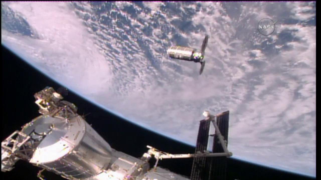 The Cygnus space cargo ship approaching the International Space Station (Image NASA TV)
