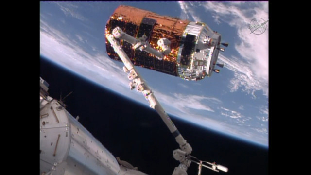 The HTV-6 cargo spacecraft capture by the International Space Station's robotic arm (Image NASA TV)