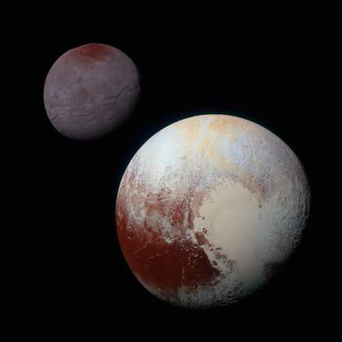 Pluto with Charon in the background (Image NASA/JHUAPL/SwRI)