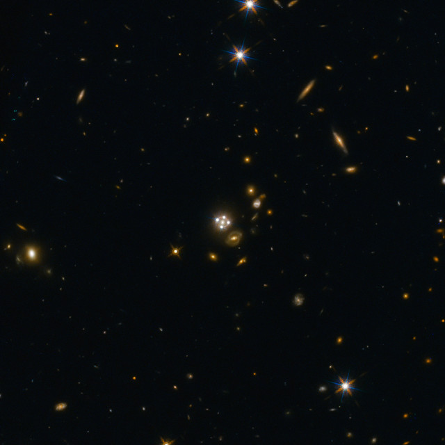 The quasar HE0435-1223 seen through a gravitational lens that creates four images of it (Image ESA/Hubble, NASA, Suyu et al.)