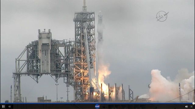 SpaceX Dragon cargo spaceship blasting off atop a Falcon 9 rocket to start its CRS-10 mission (Image NASA TV)