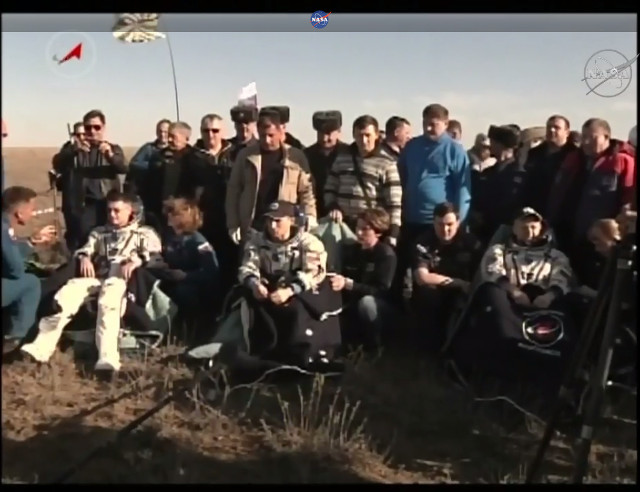 Shane Kimbrough, Sergey Ryzhikov and Andrey Borisenko assisted after their landing (Image NASA TV)