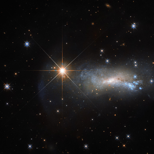 The galaxy NGC 7250 and the star TYC 3203-450-1 (Image ESA/Hubble & NASA)