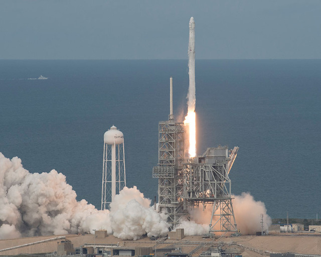 The Dragon space cargo ship blasting off atop a Falcon 9 rocket (Photo NASA/Bill Ingalls)