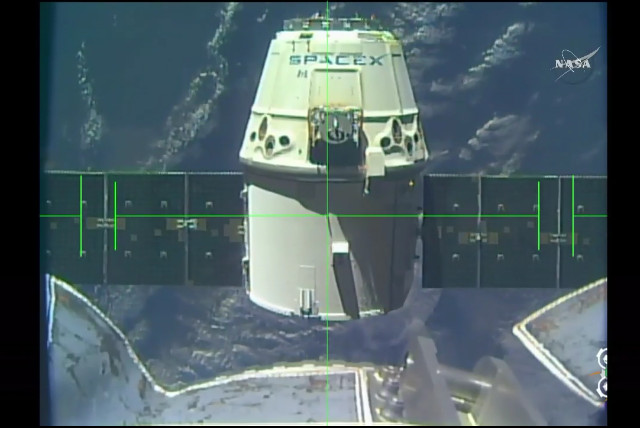 The Dragon cargo spacecraft leaving the International Space Station (Image NASA TV)