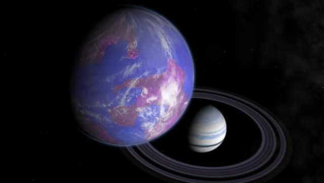 Artist's concept of a gas giant planet with a habitable exomoon (Image courtesy Andy McLatchie)