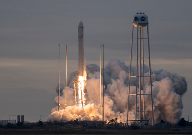 The Cygnus spece cargo ship blasting off atop an Antares rocket (Photo NASA/Bill Ingalls)