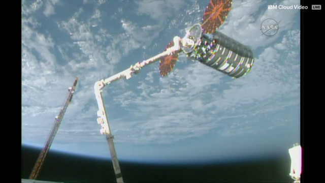 The Orbital ATK Cygnus Gene Cernan cargo spacecraft captured by the Canadarm2 robotic arm (Image NASA TV)