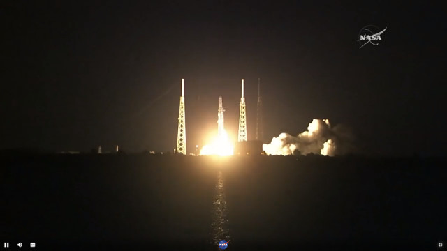 The Dragon space cargo ship blasting off atop a Falcon 9 rocket in its CRS-15 mission (Image NASA TV)