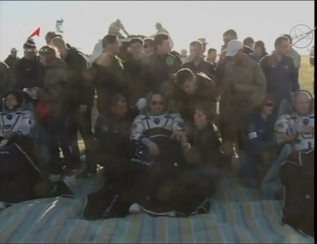 Norishige Kanai, Anton Shkaplerov and Scott Tingle after landing (Image NASA TV)