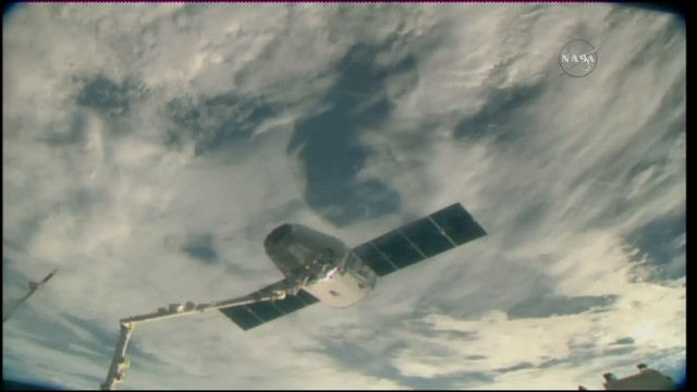 The Dragon cargo spacecraft captured by the Canadarm2 robotic arm of the International Space Station (Image NASA TV)