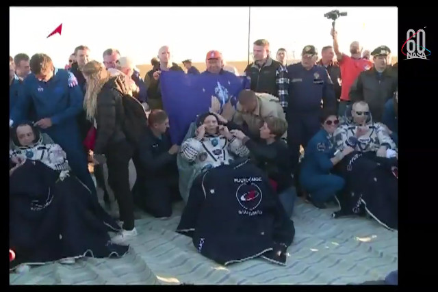 Ricky Arnold, Oleg Artemyev and Drew Feustel after landing (Image NASA TV)