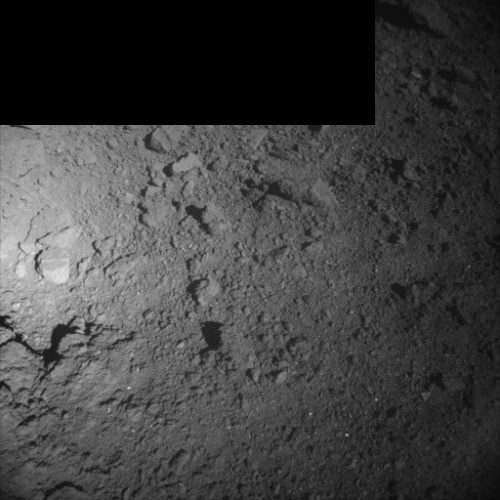 Photo of asteroid Ryugu's soil taken by the ONC-W1 camera (Photo courtesy JAXA. All rights reserved)