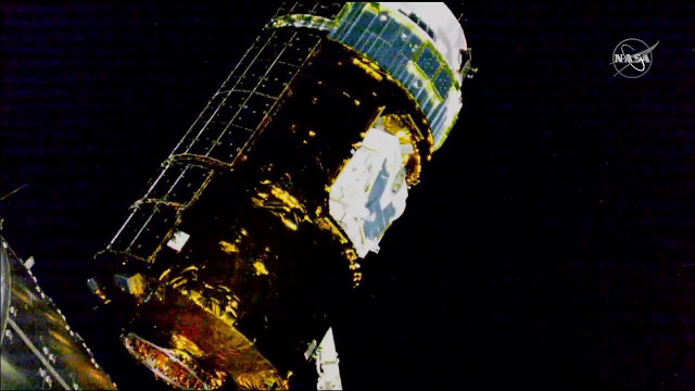 The HTV-8 cargo spacecraft captured by the International Space Station's Canadarm2 robotic arm (Image NASA TV)