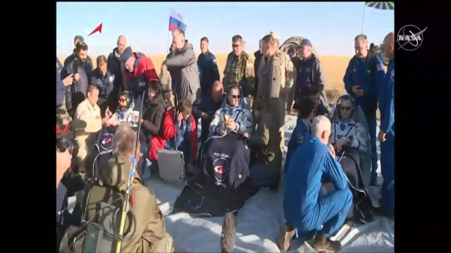 Nick Hague, Alexey Ovchinin and Hazzaa Ali Almansoori assisted after their landing (Image NASA TV)
