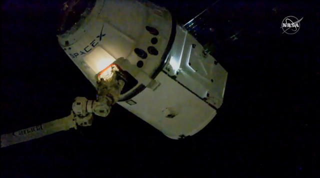 SpaceX's Dragon cargo spacecraft captured by the Canadarm2 robotic arm on the International Space Station (Image NAAS TV)