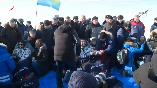 Christina Koch, Alexander Skvortsov and Luca Parmitano assisted after their landing (Image NASA TV)