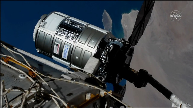 The Cygnus Katherine Johnson cargo spacecraft captured by the Canadarm2 robotic arm (Image NASA TV)