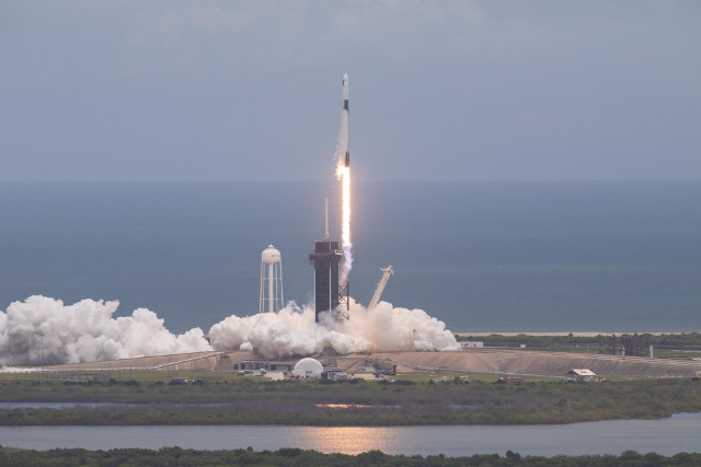 SpaceX's Dragon 2 cargo spacecraft blasting off atop a Falcon 9 rocket (Photo NASA/Kim Shiflett)