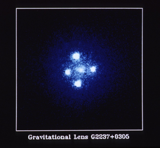 The quasar Q2237+0305 nicknamed Einstein Cross photographed by the Hubble Space Telescope (Image NASA, ESA, and STScI)