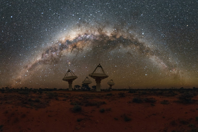 Some ASKAP antennas with the Milky Way overhead (Image courtesy Alex Cherney/CSIRO. All rights reserved)