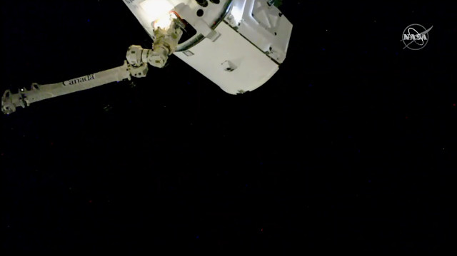 The Dragon spacecraft captured by the Canadarm2 robotic arm on the International Space Station (Image NASA TV)