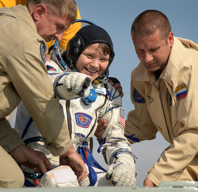 NASA astronaut Anne McClain assisted after her landing (Photo NASA/Bill Ingalls)