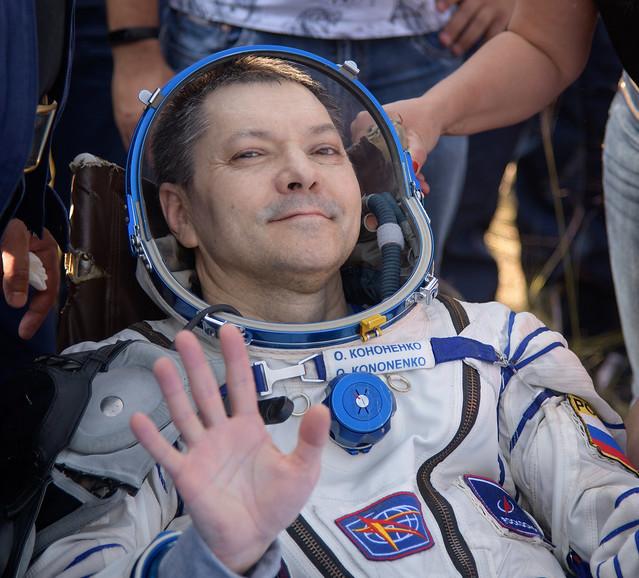 Cosmonaut Oleg Kononenko assisted after his landing (Photo NASA/Bill Ingalls)