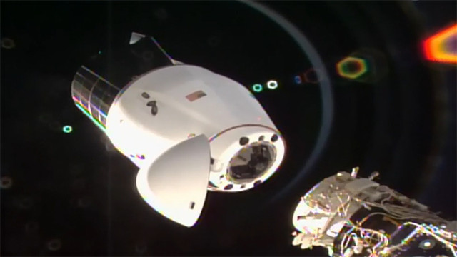 The Dracon cargo spacecraft departing the International Space Station (Image NASA TV)